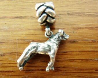 Small silver dog charm.
