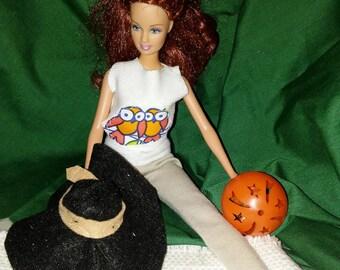 Barbie Owl tshirt, slacks, and sun hat