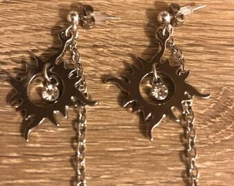 Sun flare dangle earrings