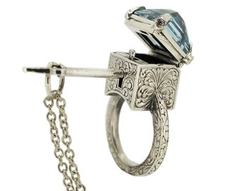 Mystic Chamber Ring - Sterling silver poison ring with topaz, sapphires and accompanying key.