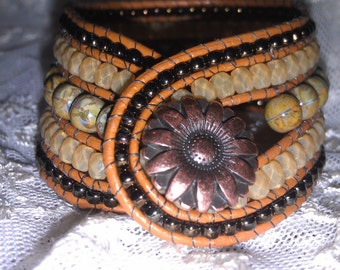 Lovely green, soft yellow and dark bronze 5 row beaded leather cuff