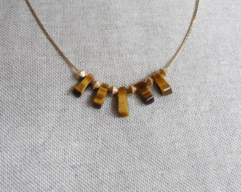 Tiyi 24K gilded necklace and tiger eye beads