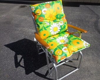 A fantastic 1960s-70s vintage  retro Lawn outdoor patio glider rocking chair with the vintage flowered cushion.excellent shape