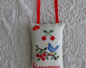 Cross-stitched welcome door cushion