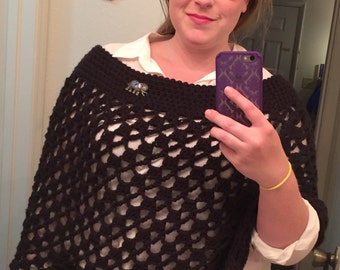 Crocheted Trellis Poncho with elephant brooch. Customization