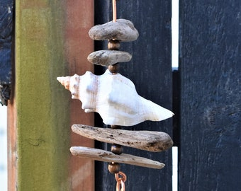 This wonderful ocean themed hanger brings driftwood and shells right into your home both indoors and outdoors.