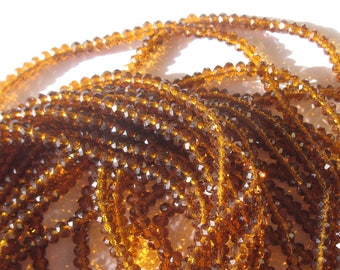 30 (23) 6mm amber colored faceted glass beads