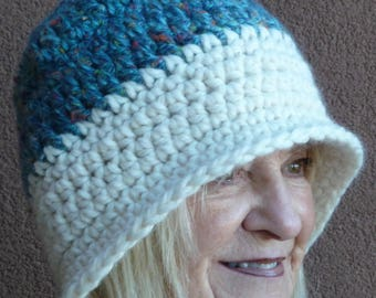Heavy blue and white yarns make for a warm winter hat, women's crochet winter hat with versatile style, you choose the style