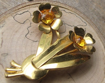 vintage brass flower brooch with topaz rhinestones
