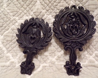 """Set of 2 Small Trivets - 1 marked """"Wilton"""" 1 marked 9-23 Eagle"""