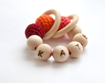 Personalized teething toy with crochet wooden beads and 2 wooden rings. Wooden beads rattle.