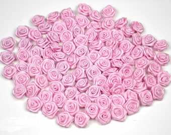 20 skulls with pink satin rose 2 cm in diameter