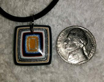 Fordite handcrafted one of a kind pendants