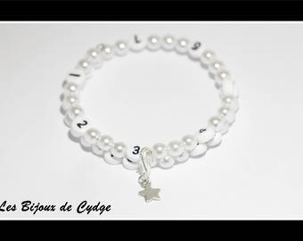 Nursing bracelet on memory wire form of 55mm with white acrylic beads