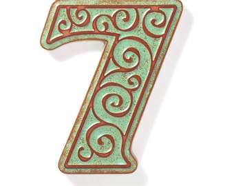 ceramic house number 7 , green-brown