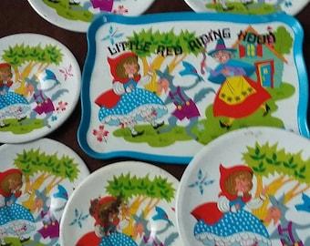 Child tin plates by Ohio Art.