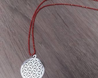 Red ball chain and silver ethnic pendant