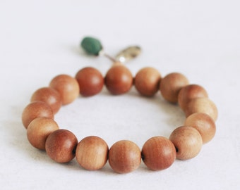Aromatic Sandalwood bracelet with Petoskey fossil stone and green slag glass nugget