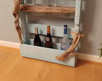 Wine rack made from pallet wood w/ driftwood shelf and accents.