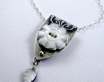 Vintage Button Necklace: Flower Mother of Pearl Button with Shield Setting and Mother of Pearl Leaf Dangle