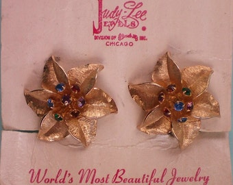 Judy Lee Gold tone Star Flower Clip Earrings - 4125