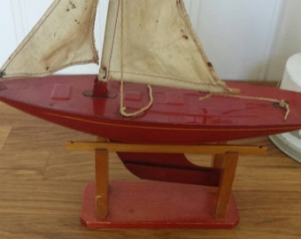 Tin toy pond yacht, sailing boat, red, Tri-ang toys, Lines bros. Ltd.