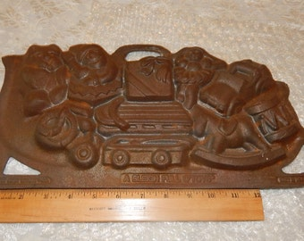 Cast Iron '' A Sleigh Full O' Toys'' Cookie Mold made in USA by John Wright for Christmas Baking or Decor