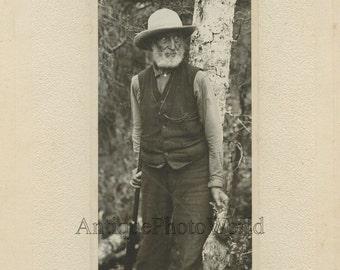 Old hunter w rifle dead bird pheasant antique art photo