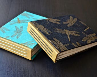 Beautiful handmade journal with exposed stitches, covered in Nepalese dragonflies paper