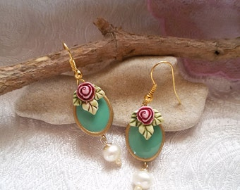 Oval turquoise earrings with sculpted rose and pearl   Hand made: porcelain and glazed in shades of turquoise and fresh water pearl