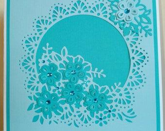 Light teal on teal flower Circle card