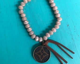 Beaded Bracelet with Repurposed LV Pendant and Tassel