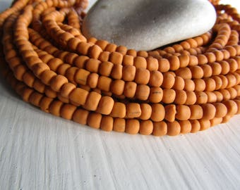 orange glass seed bead, matte opaque barrel tube, small rustic ethnic spacer , indonesian 3 to 6mm, new indo-pacific (22 inches)7ab29-6