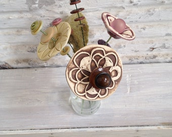light green, light purple and brown button flower bottle bouquet