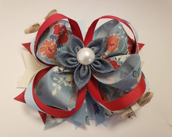 Beautiful and delicate blue flower hair bow.