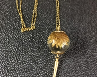Womans natural gold thistle necklace