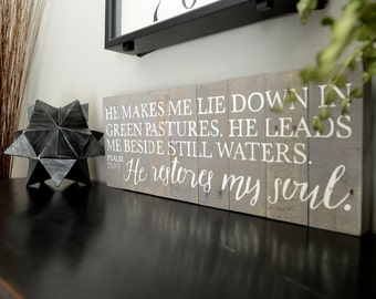 Psalm 23 - He makes me lie down in green pastures. He leads me beside still waters. He restores my soul