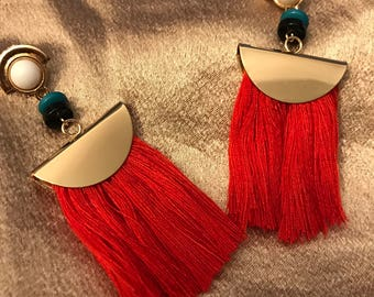 Red and gold earrings.