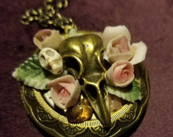 Bronze bird skull locket with stone skull