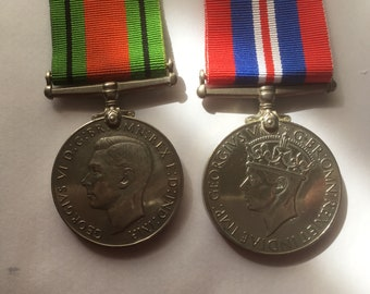 A pair of Second World War British Medals - The Defence Medal and The War Medal.
