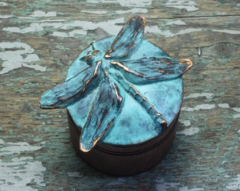 Dragonfly sculpture on wooden round box