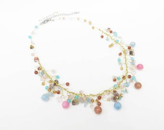 Pastel blue and pink stone necklace with crystal on gold silk thread, light brown, cream, pink, light blue