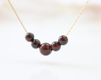 Garnet Gold Necklace • Garnet gemstone beads on a gold necklace • January birthstone necklace