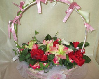 Basket of artificial flowers for wedding ceremony