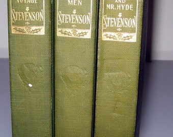3 cloth bound hard cover books by Robert Louis Stevenson: Merry Men, Treasure Island, Dr Jekyll & Mr Hyde