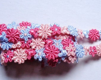 7/16 inch wide Embroidered flower trim selling by the yard