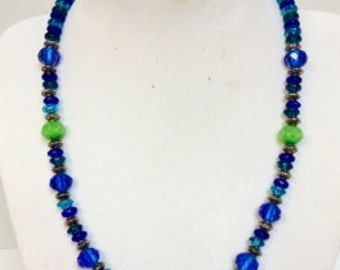 Glass Bead Necklace in shades of Blues and Greens, touch of Purple..... lobster clasp, 17 inches long.