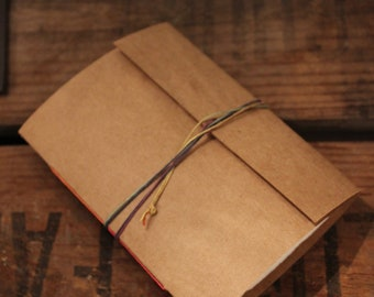 small handmade sketchbook A7 bound with natural hemp cord