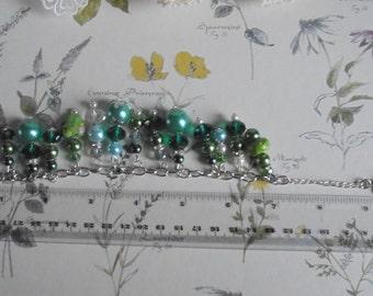 Shades of green glass pearl and Czech crystal charm bracelet. Friendship bracelet. Beaded bracelet. Statement jewellery.
