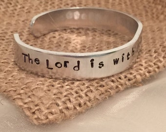 """Warrior Scripture cuff bracelet Judges 6:12 """"The Lord is with you, mighty warrior."""" Silver-toned 12 gauge aluminum hypoallergenic 6"""" x 3/8"""""""